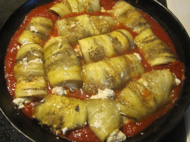 Name:  Eggplant involtini 3 - simmering in sauce.JPG